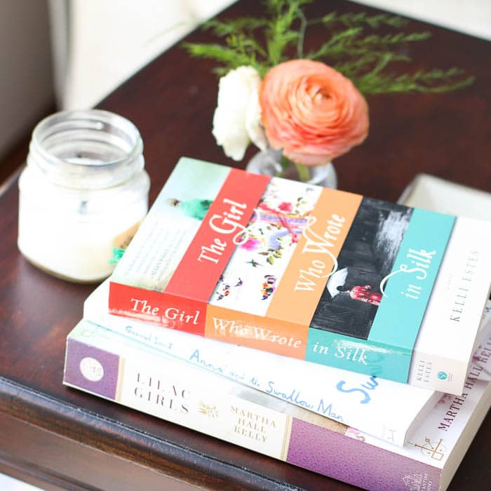 nightstand with books and flowers