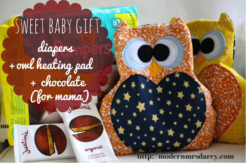 For a sweet baby gift combine something homemade with useful staples every family needs. (Because every postpartum mom needs chocolate, right?) This baby gift combines a handmade rice-filled owl-shaped heating pad with diapers and chocolate.