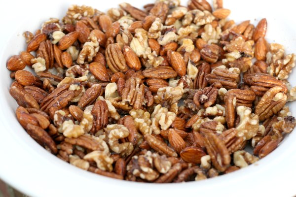 This wonderful spiced nuts recipe has all the holiday flavor but only half the sugar. This is any easy technique, so simple even the kids can make them. Also good for holiday gift-giving.
