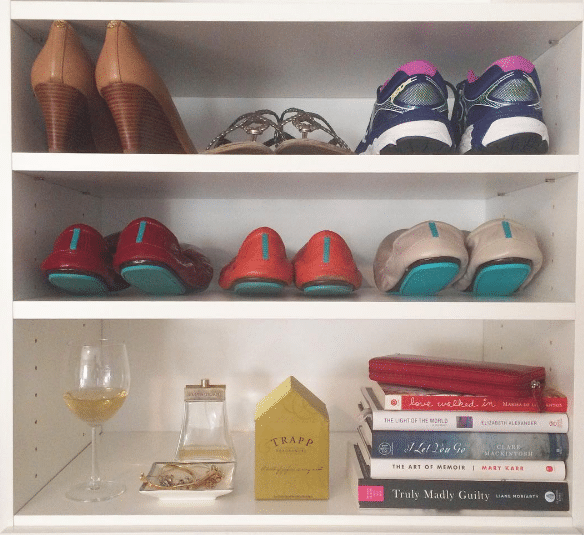 new closet shelves with tieks, books, and wine