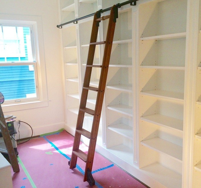 the shelves were custom built we have ten foot ceilings the shelf base is 5 12 the ladder rail is 3 12 the frieze above the top shelf is 5 - Library Built In Bookshelves