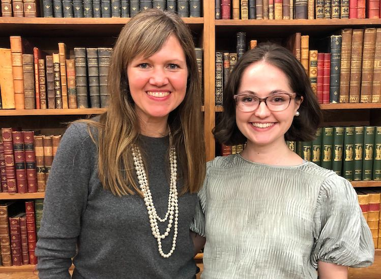 Anne and Robyn Smith post in front of some of the rare books at the Strand.