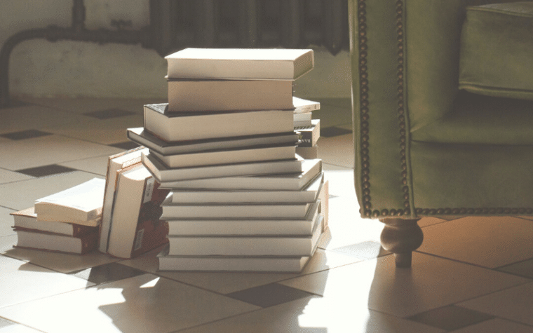 a stack of books in sunlight
